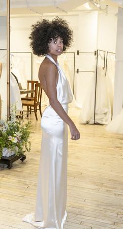 New York, NY, USA - April 13, 2019: A models shows out dress for Savannah Miller Spring 2020 Presentation during New York Bridal Week at 43 West 24th Street, Manhattan Редакционное