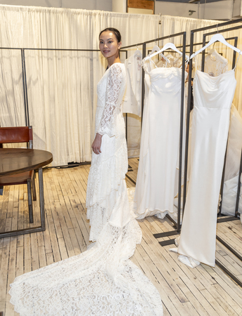New York, NY, USA - April 13, 2019: A models shows out dress for Savannah Miller Spring 2020 Presentation during New York Bridal Week at 43 West 24th Street, Manhattan Redakční