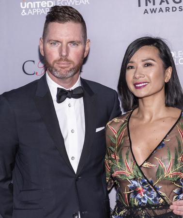 New York, NY, USA - April 15, 2019: Douglas Hand and Monica Phromsavanh attend AAFA American Image Awards 2019 at The Plaza, Manhattan