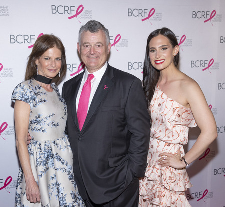New York, NY, USA - May 15, 2019: Lori Kanter Tritsch, William P. Lauder and Alex Tritsch attend the Breast Cancer Research Foundation 2019 Hot Pink Party at Park Avenue Armory, Manhattan