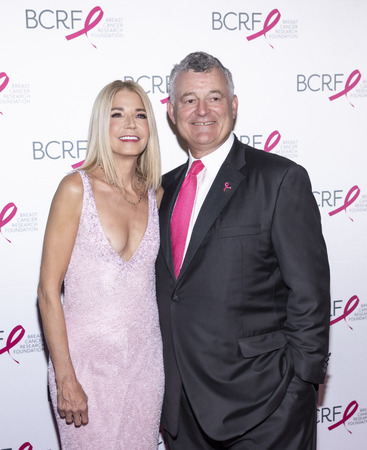 New York, NY, USA - May 15, 2019: Candace Bushnell and William P. Lauder attend the Breast Cancer Research Foundation 2019 Hot Pink Party at Park Avenue Armory, Manhattan Sajtókép