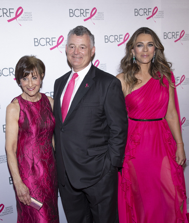 New York, NY, USA - May 15, 2019: BCRF President Myra J. Biblowit, William P. Lauder and Elizabeth Hurley attend the Breast Cancer Research Foundation 2019 Hot Pink Party at Park Avenue Armory, Manhattan Sajtókép