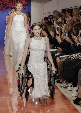 NEW YORK, NY, USA - October 3, 2019: Bri Sclesse and models on the runway finale at the Theia Fall 2020 collection during New York Bridal Week at the Theia Showroom, Manhattan
