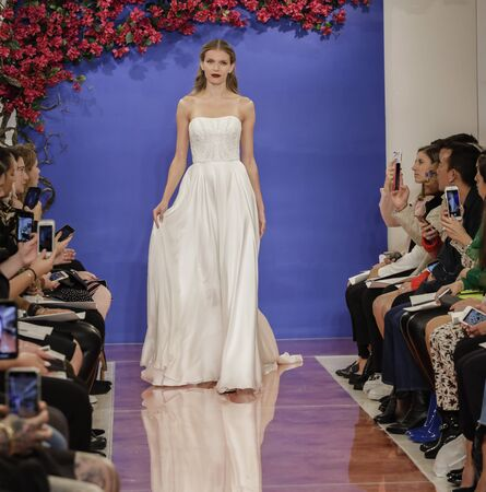NEW YORK, NY, USA - October 3, 2019: A model walks the runway at the Theia Fall 2020 collection during New York Bridal Week at the Theia Showroom, Manhattan