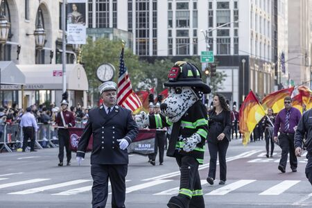 New York, NY, USA - October 14, 2019: New York Fire Department mascot Marching Up Fifth Avenue during 75th Annual Columbus Day Parade, Manhattan. The annual Columbus Day parade, the largest celebration of Italian-American heritage and culture in the Unite