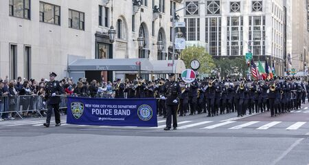 New York, NY, USA - October 14, 2019:  Police Band of NYC Police Department Marching Up Fifth Avenue during 75th Annual Columbus Day Parade, Manhattan. The annual Columbus Day parade, the largest celebration of Italian-American heritage and culture in the Editorial