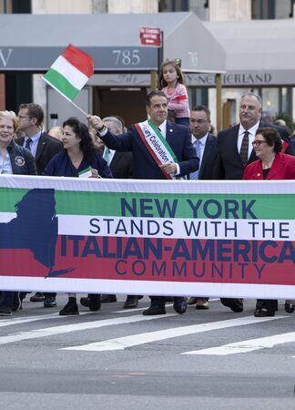 New York, NY, USA - October 14, 2019: New York Governor Andrew Cuomo Marching Up Fifth Avenue during 75th Annual Columbus Day Parade , Manhattan. The annual Columbus Day parade, the largest celebration of Italian-American heritage and culture in the Unite