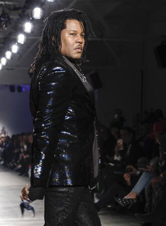 New York, NY, USA - February 5, 2020: Ty-Ron Mayes walks Blue Jacket runway in support of mens health and prostate cancer awareness at Pier 59 Studios , Manhattan