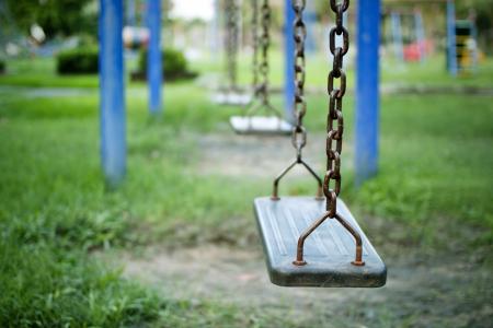 kids at play: Swings, childrens playground.