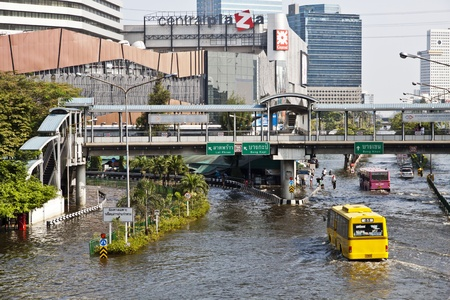 Square Lat Phrao, Bangkok. The flood high,Thai people have a difficult journey. And water to flow into the city without stopping.