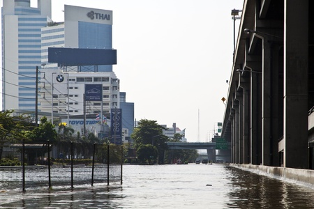 difficult journey: Square Lat Phrao, Bangkok. The flood high,Thai people have a difficult journey. And water to flow into the city without stopping.