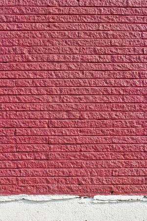 plaster wall: La superficie est� hecha de ladrillo rojo de fondo.