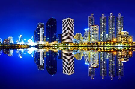Bangkok city downtown at night with reflection of skyline, Bangkok,Thailand photo
