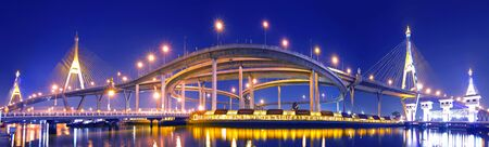 Bhumibol Bridge in Thailand, also known as the Industrial Ring Road Bridge, in Thailand. The bridge crosses the Chao Phraya River twice. photo