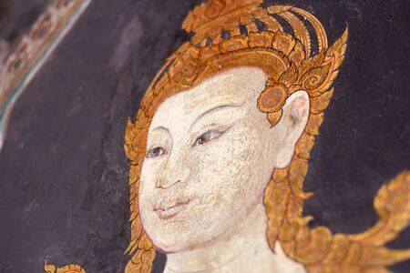 Wall painting of Thai female angel at Grand Palace, Bangkok, Thailand.