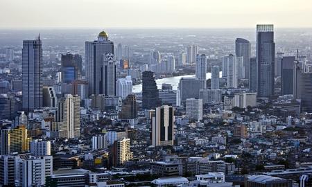 bird eye view: Modern skyscraper city streets in the evening,Bangkok,Thailand Stock Photo