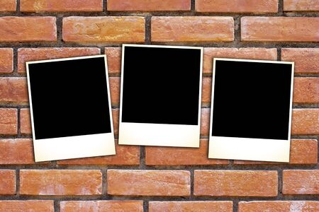blank vintage paper and photo frame on brick background photo
