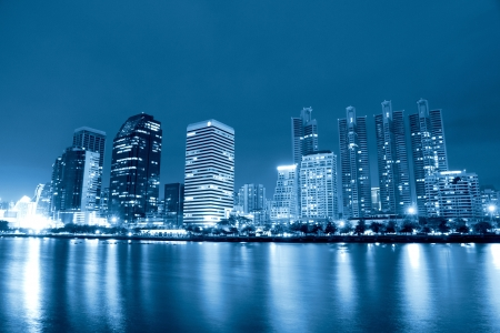 City at night, panoramic scene of downtown reflected in water,thailand photo