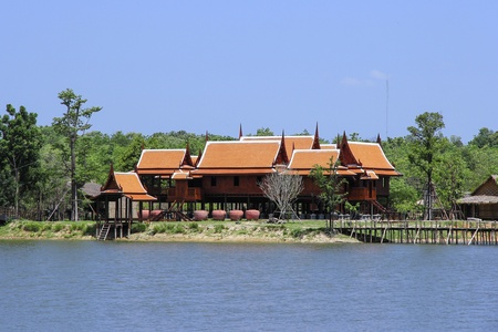 house float on water: Thai style house built in Riverside Kanchanaburi in Thailand