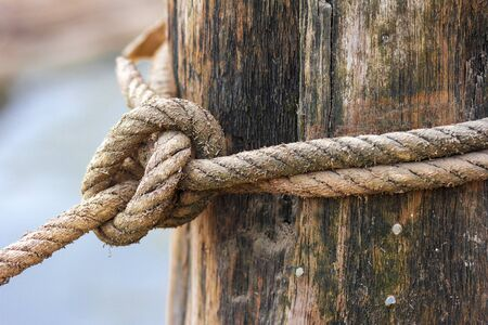 texture twisted: strong knot tied by a rope Stock Photo