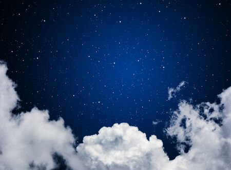 starfield: looking out to the stars in space or night sky through the clouds Stock Photo