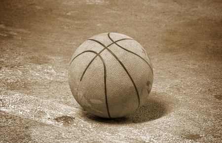 college basketball: Old basketball. Screw on the dark background. Stock Photo