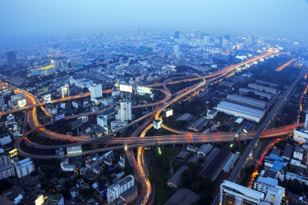 A busy freeway at night in the city. Bangkok Thailand. photo