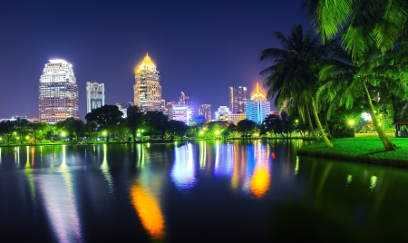 Night scene of Bangkok skyline at dusk from Lumphini Park photo