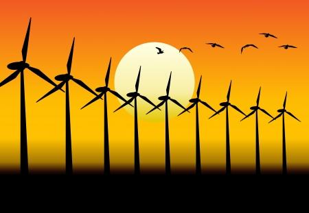 Alternatieve groep energieproducerende windmolens met zonsondergang achtergrond.