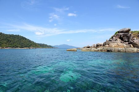 azure coast: The coastal water green with sky blue coral islands. Stock Photo