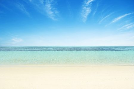 Beaches, crystal clear water, blue sky as background.