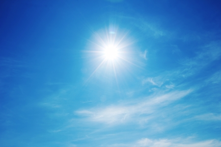 The sun shines bright in the daytime in summer. Blue sky and clouds. Stock Photo - 19223795