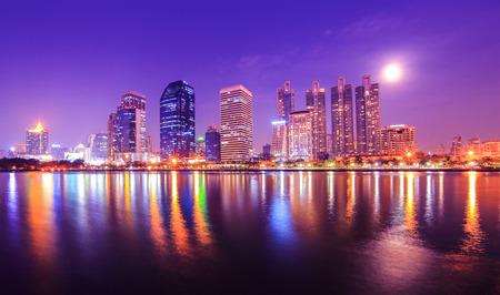 Bangkok city downtown at night with reflection of skyline, Bangkok,Thailand photo