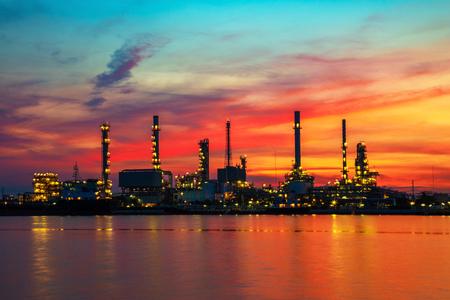 sea pollution: Oil refinery at twilight
