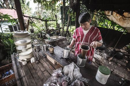 origin of man: Chiang Mai,Oct 17: Indigenous men were made to drink the coffee.At Ban Mae Klang Luang, Chiang Mai, Thailand. on Oct 17, 2015.