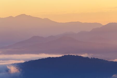 mist: Mountain and mist in morning Stock Photo