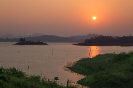 lake sunset: Sunset at the lake with a beautiful orange light. Pompey, Kanchanaburi, Thailand.