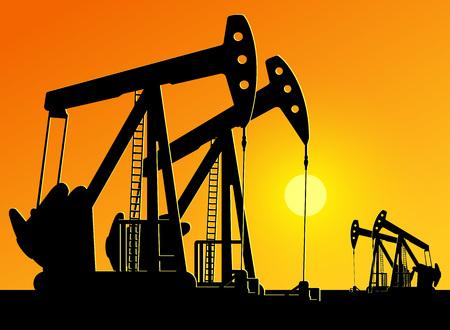 silhouette de pompes à huile de travail sur fond de coucher de soleil