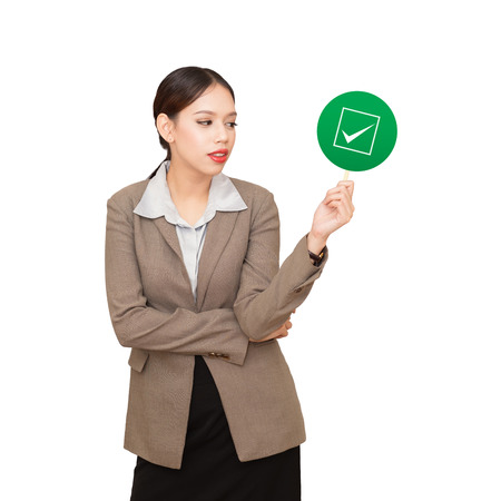 business woman is holding a checkbox, a concept of decision making process. Stock Photo