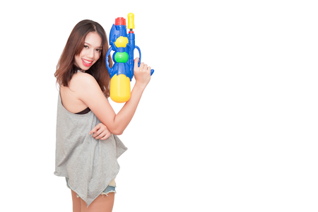 Girl holding a water gun and happy playing (for Songkran festival  day in Thailand). isolated on a white background