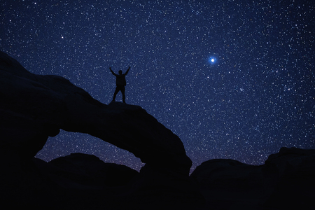 sky night: Man who feels on top of the world looking at the star