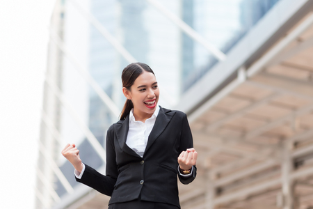 Young Business Woman celebrating a successful work day Фото со стока