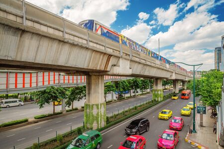Bangkok - Thailand 16 July 2019: Bangkok City Transportation System. BTS with a taxi-filled road On the day that the sky was cloudy