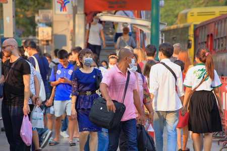 Bangkok - Thailand, 29 Feb 2020: People wearing medical masks Prevents dust and germs. In the evening there was sunshine