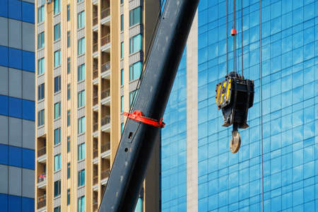 Construction crane With a background of tall buildings