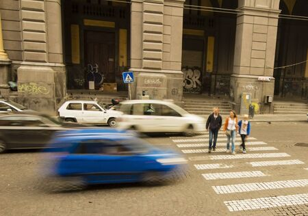 passerby: Street car danger on the walkway for passer-by in Italy Stock Photo