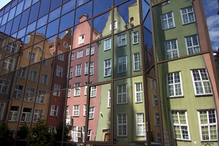 tenement: Colorful tenement houses reflected in windows of modern building in Gdansk
