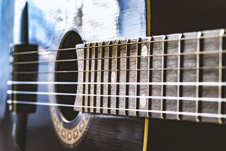 nylon string: black classic guitar close up vintage colors