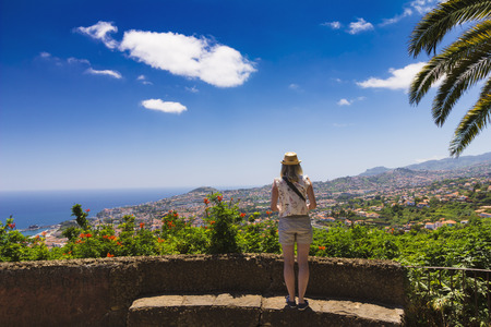 boater: Madeira island Portugal typical landscape, woman tourist admiring Funchal city panorama, wide angle