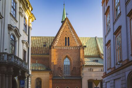 of assisi: Franciscan Church - St. Francis of Assisi in Krakow, Poland, view from Bracka street, warm colors Stock Photo